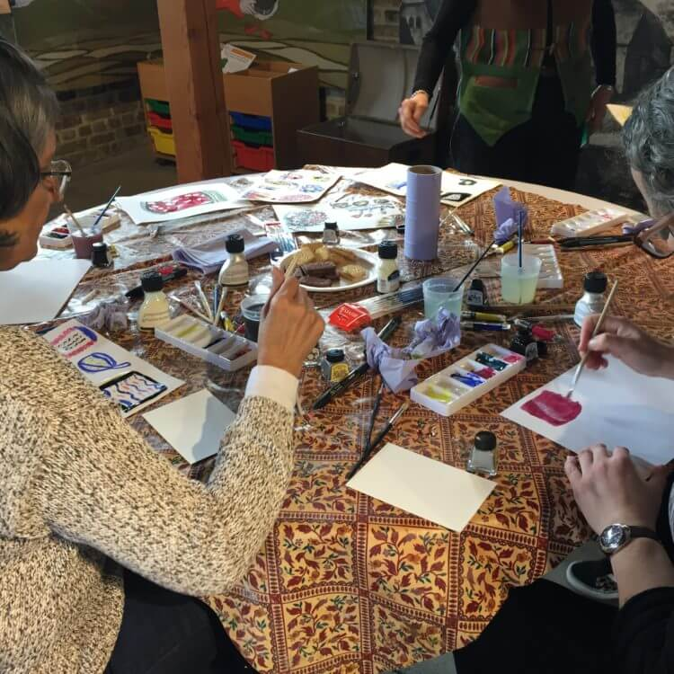 Two ladies painting in Adult Craft Club