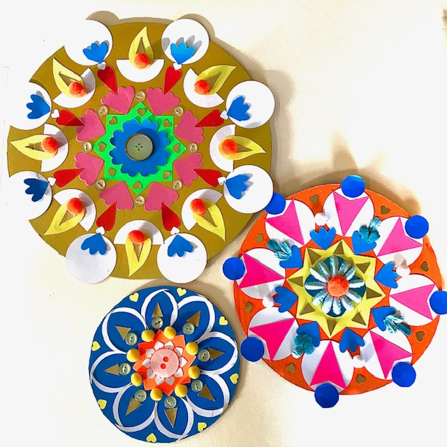 Rangoli designs in a group of three with colourful designs