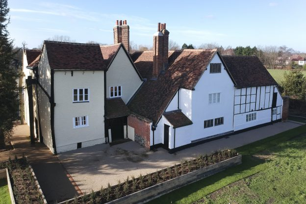 A photograph of Headstone Manor House taken from above the moated island.