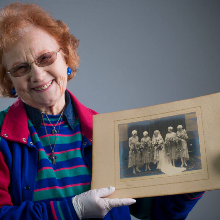 A volunteer holding an historic photograph